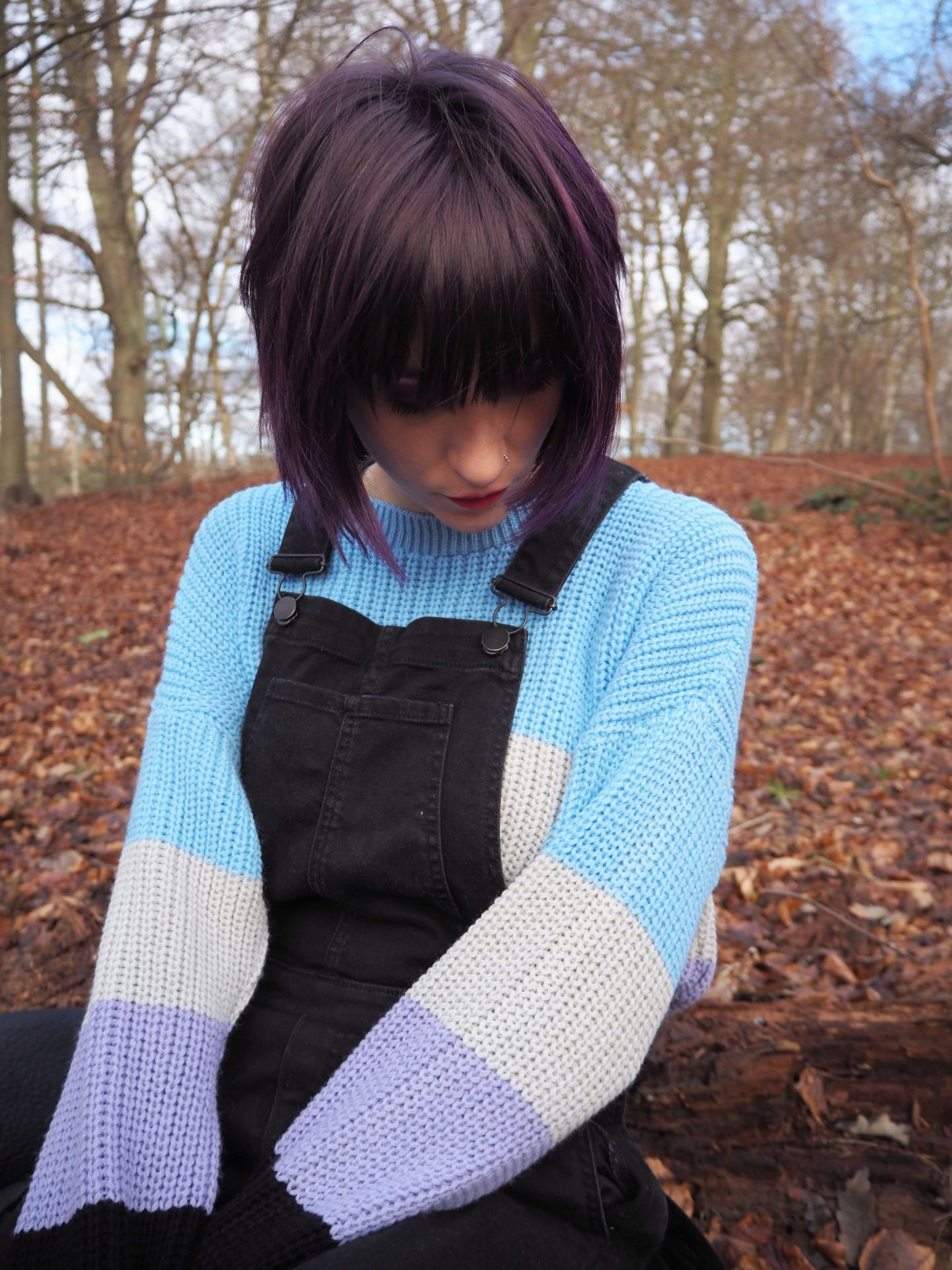 Im exhausted - closeup of jumper, hair & dungarees
