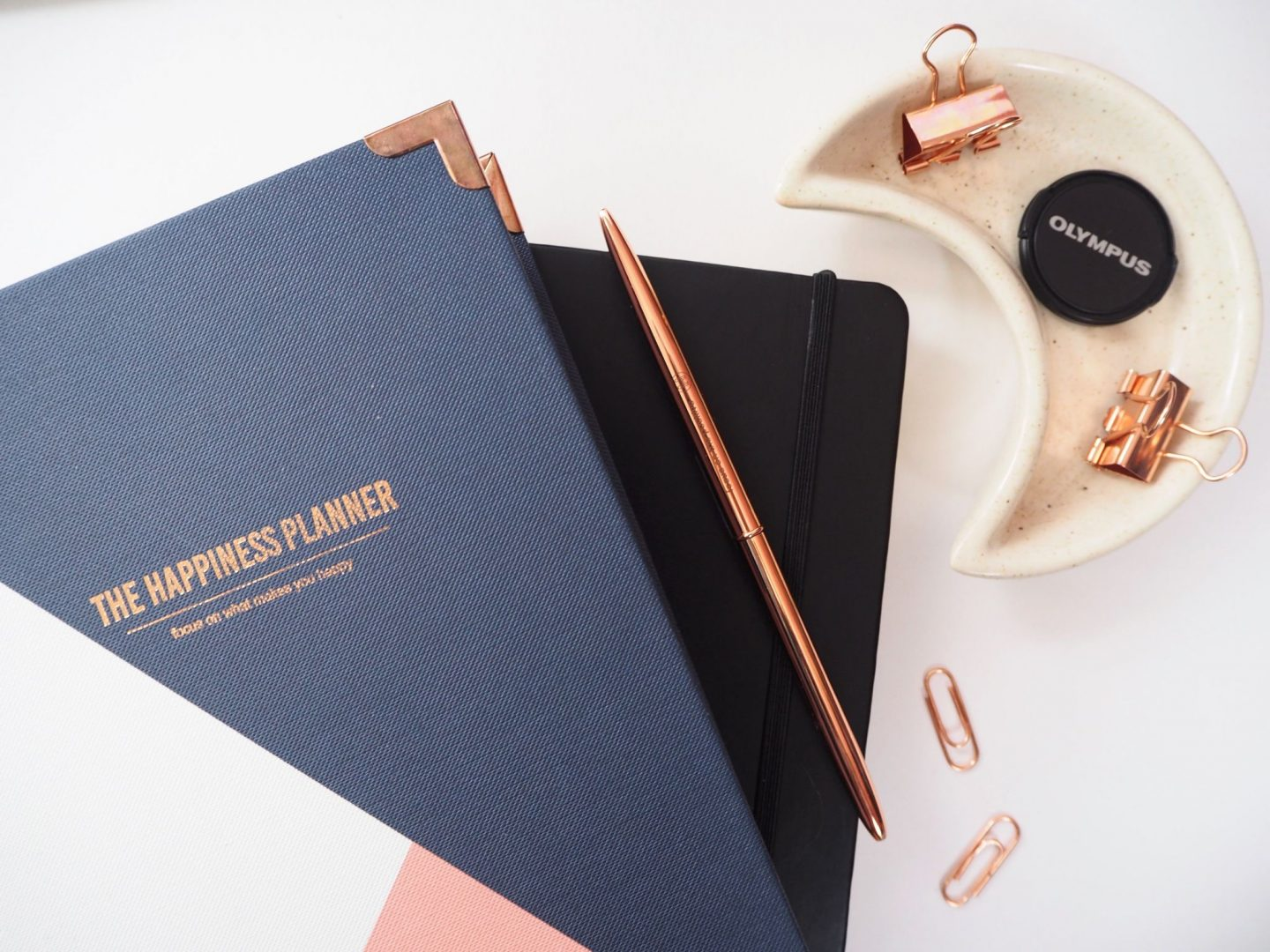 The pressure of feeling organised- happiness planner, pen & trinkets flatlay