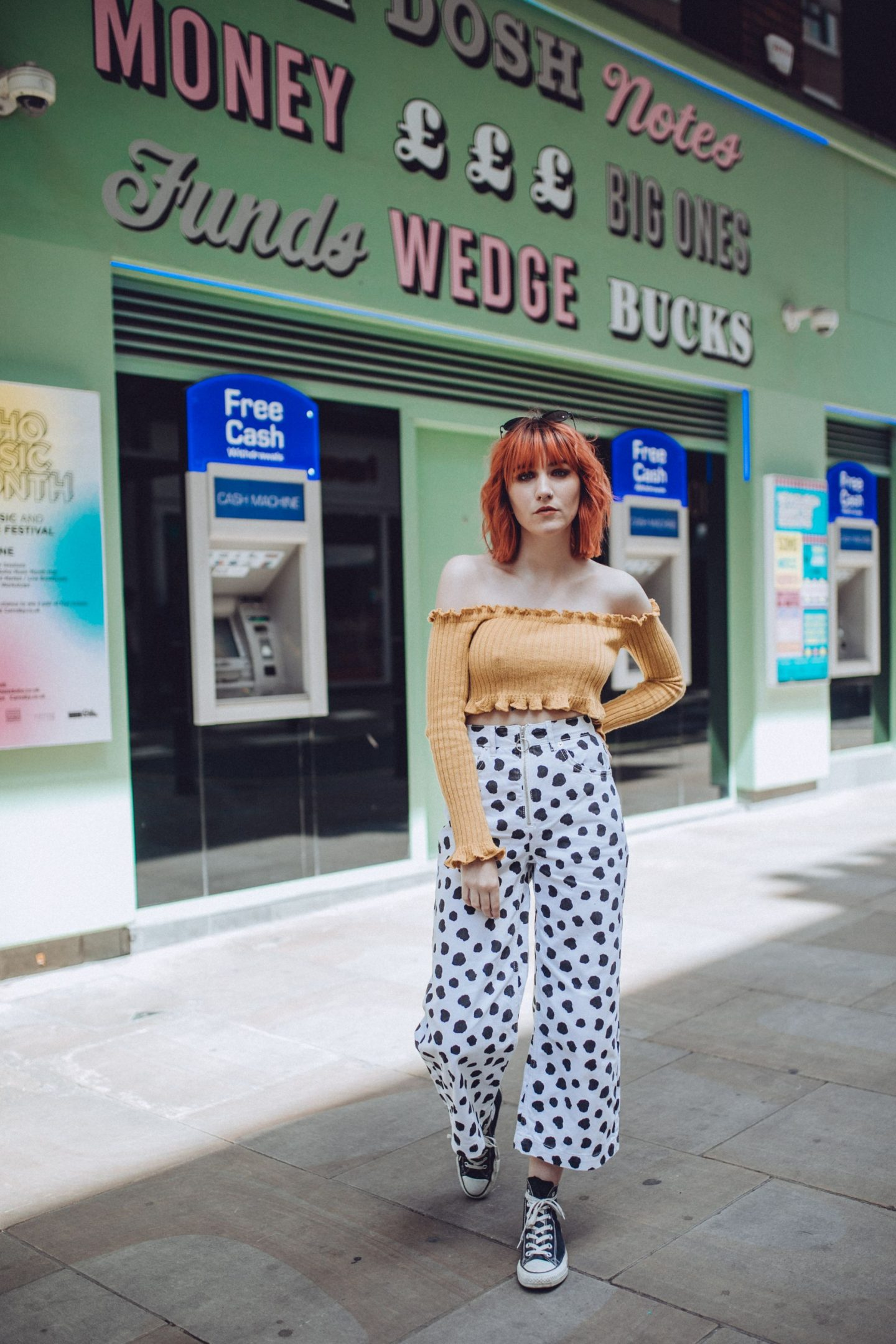 Bloggers Who Inspire Me To Dress Boldly - outfit; orange crop, spotty jeans & converse