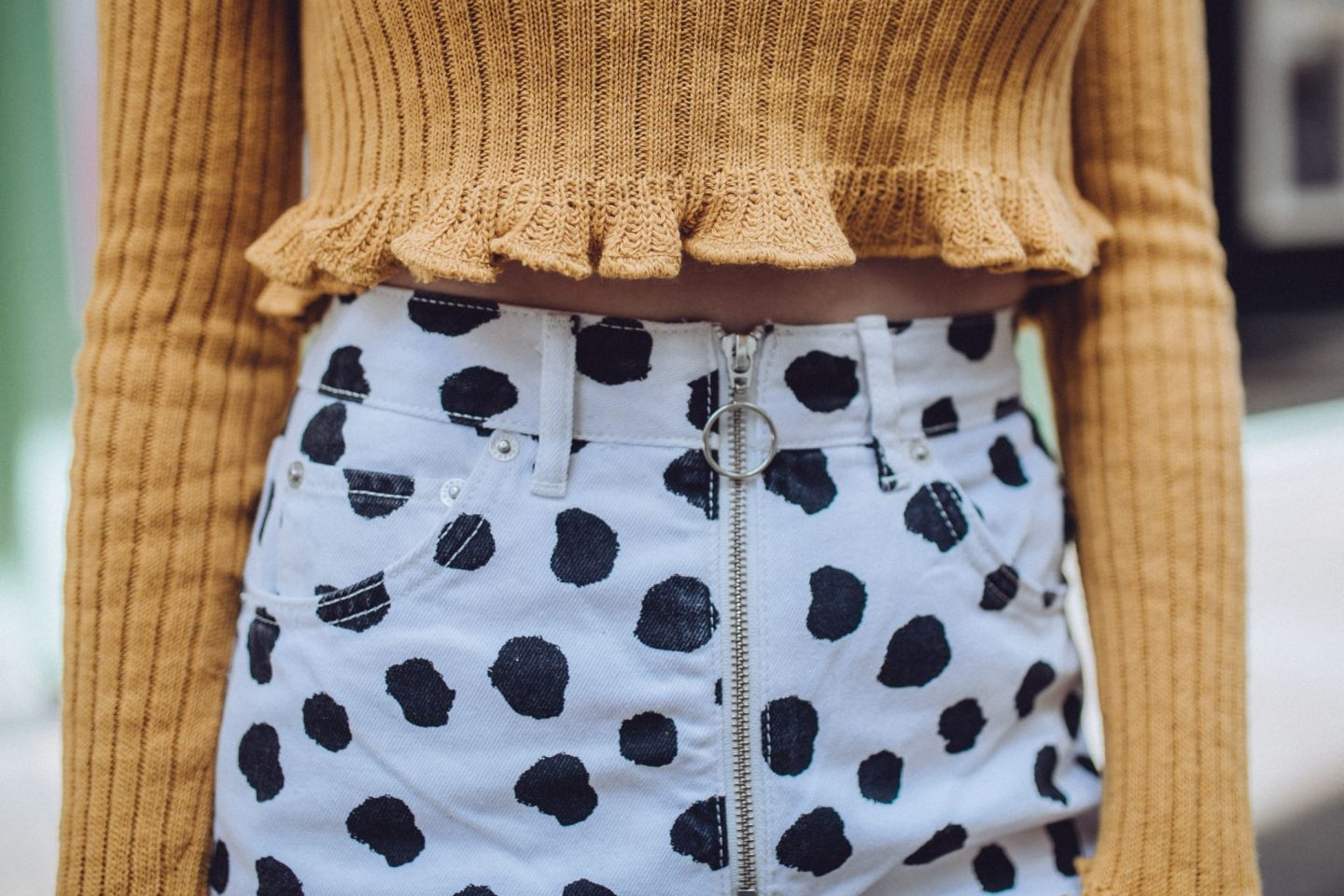 Bloggers Who Inspire Me To Dress Boldly - outfit close up; orange crop & spotty jeans