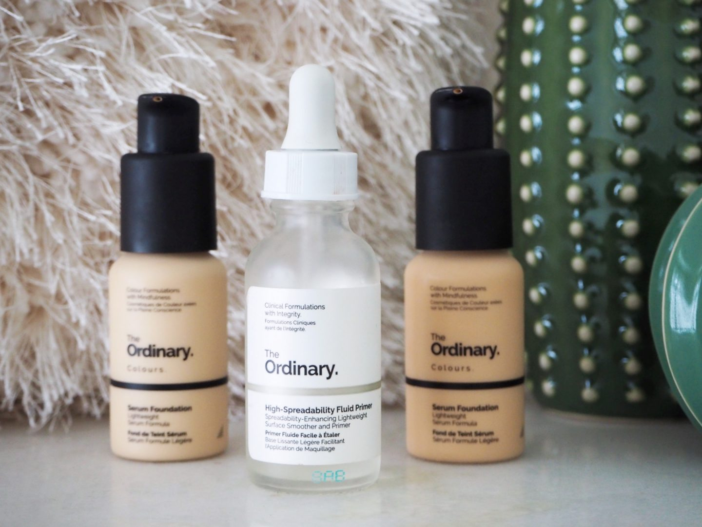 The Ordinary; The Affordable Products That Transformed My Skin - close up of serum foundations & high-spreadability fluid primer