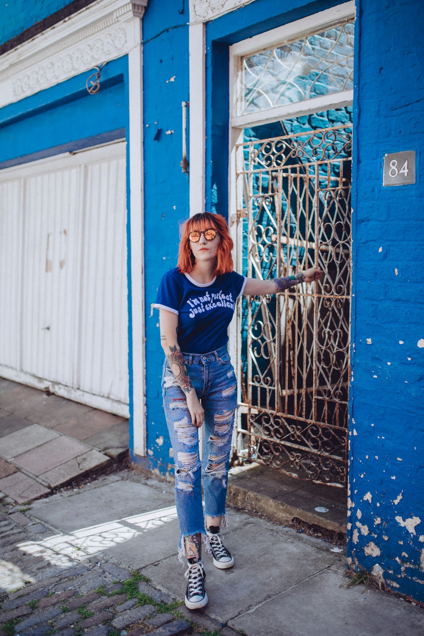 10 thoughts before turning 25 - full outfit; slogan tee, ripped jeans & converse