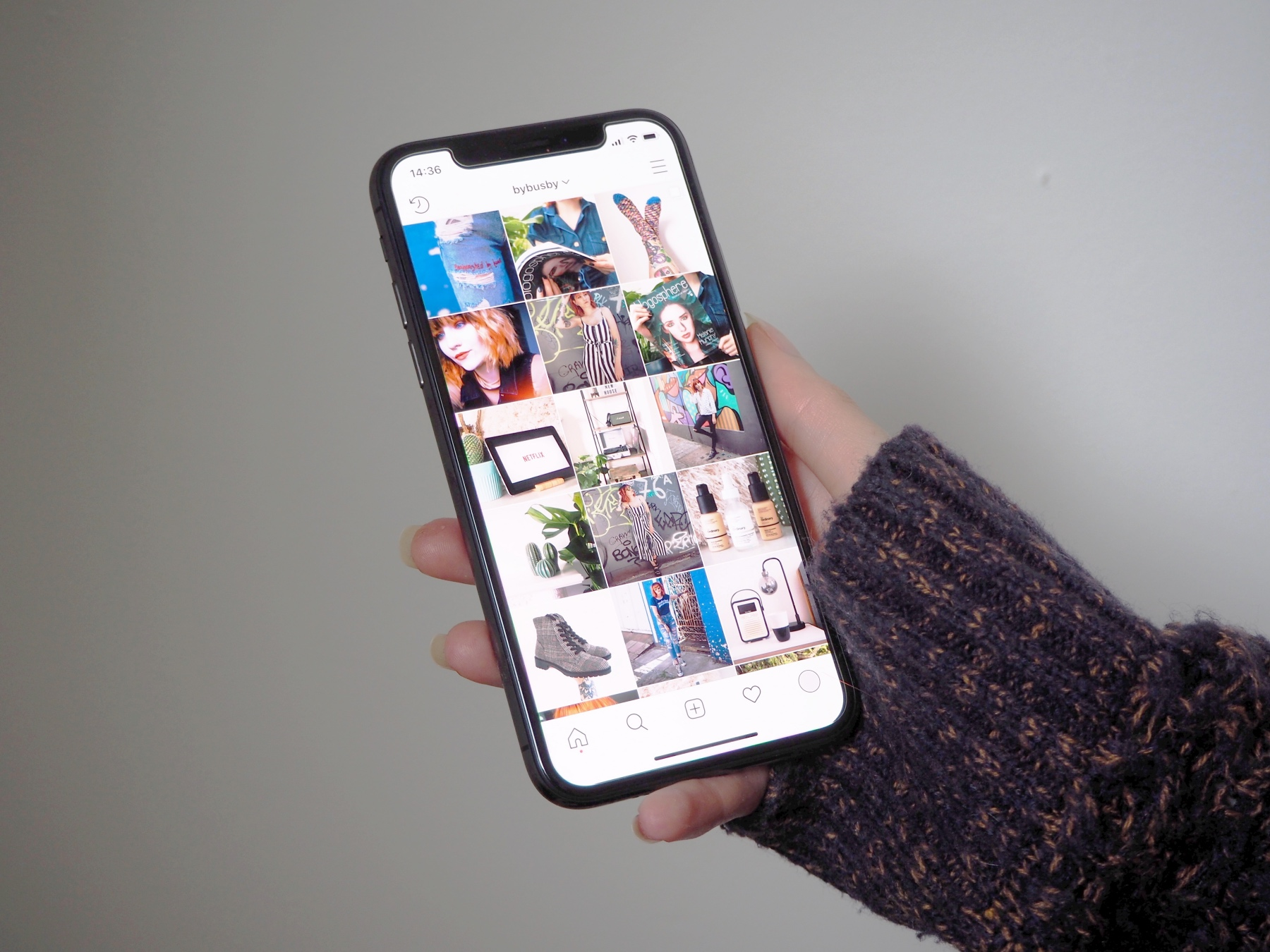 Instagram Follower Explosion - phone in hand with instagram feed
