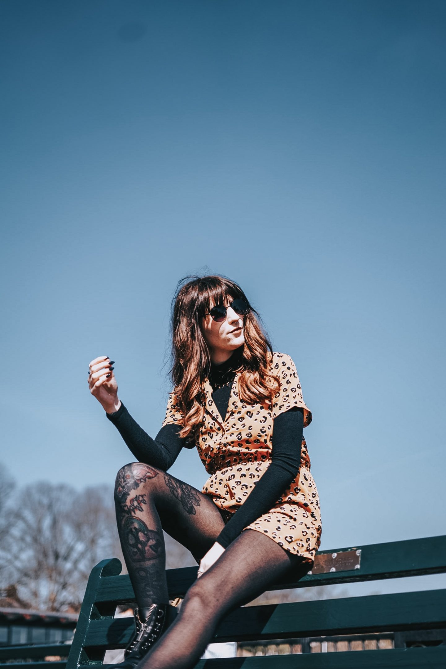 Refusing To Let Go Off My Identity - me on bench wearing leopard playsuit & black turtleneck