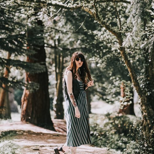 5 Unexpected Reactions When You're Pregnant - me in forest pathway in green striped midi dress, leather waistcoat & dr marten sandals