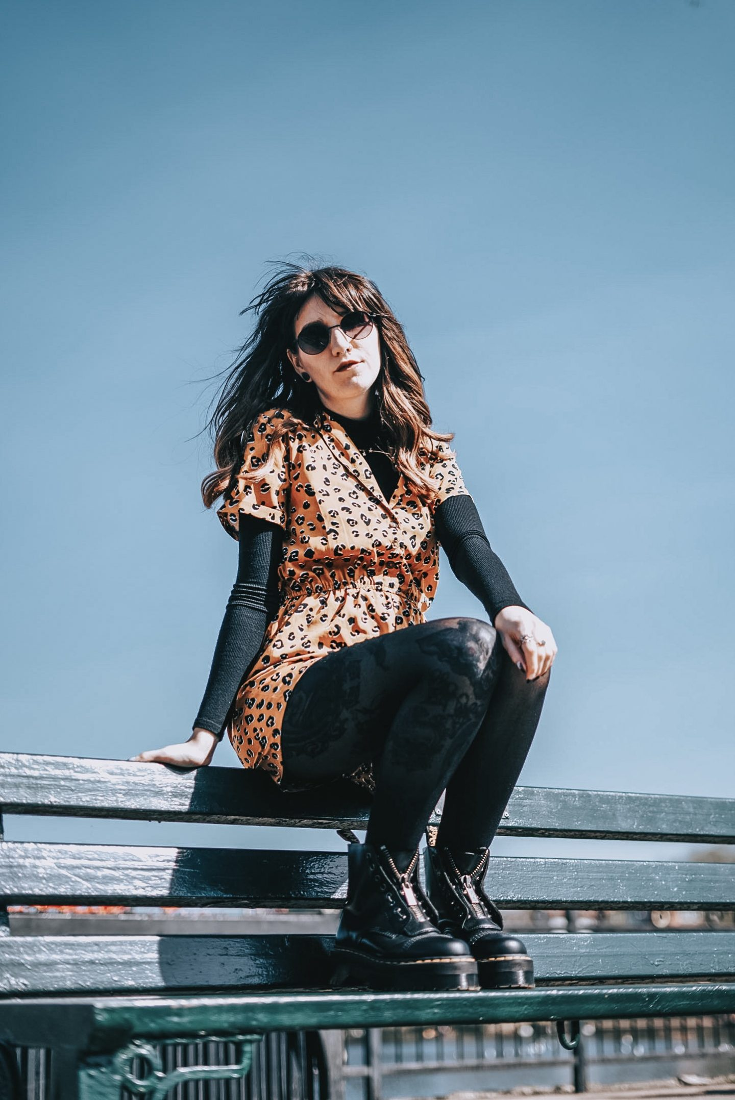My Identity Crisis In Motherhood | I'm Not Just A Mum - me on bench wearing leopard playsuit, black turtleneck, tights & dr marten boots