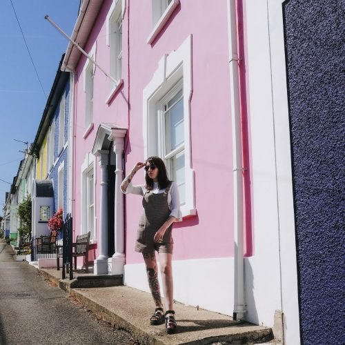 Life with a newborn - full outfit in front of pastel houses