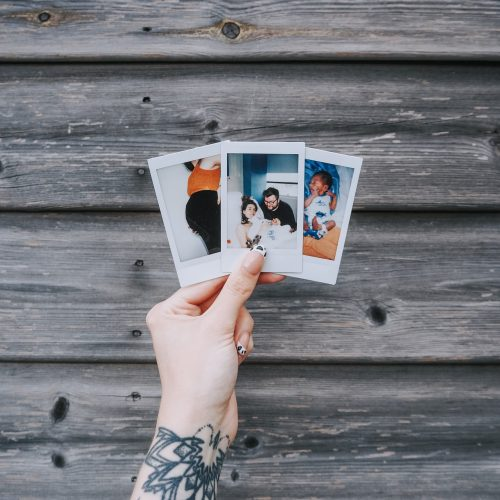 Birth Story - three polaroids against wooden fence