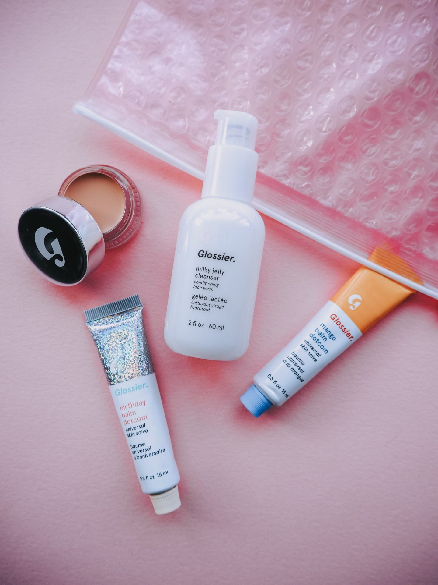 glossier first impressions - glossier milk jelly cleanser, glossier stretch concealer, glossier balm Dotcom