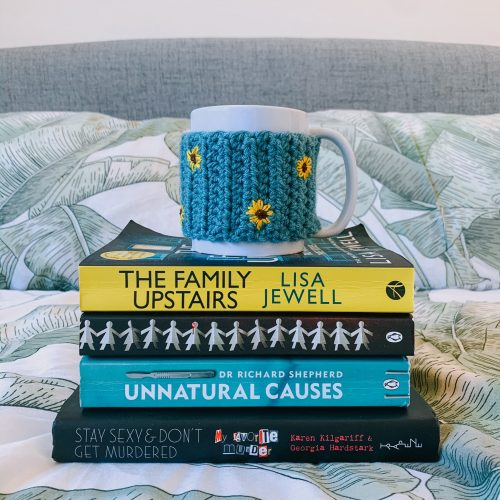 reading wrap up - book stacked with mug on top